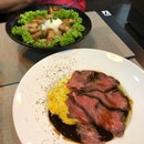 Omurice With Roast Beef ($19), Pork Belly Don ($21)