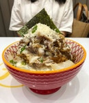 Snow Beef Don ($11.90) - A heaping bowl of juicy sliced beef, topped with what looks like parmesan shreds.