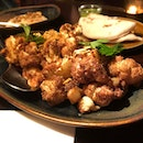 🐰 Fried Cauliflower (S$15++), served with sweet potato, spice nuts, tahini and chili sauce.