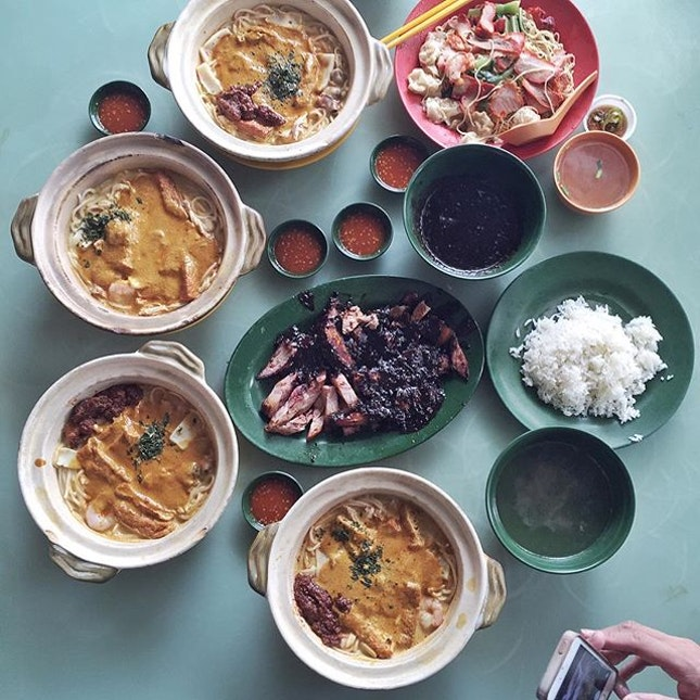 Singapore curry laksa, wantan mee, roasted duck, char siew and siew bak consumed with chap.