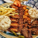 Mediterranean Mixed Grill , with Lamb shish , Adana Kebab , chicken wings, fries and rice .