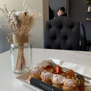 Delicious eclairs in a comfy setting