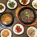 banchan orgy and a steaming bowl of fermented soybean paste stew (jjigae) at only just 8k KRW.