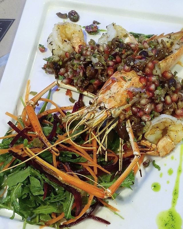 special that day at @italianosteriasg; grilled giant prawn with beetroot salad.