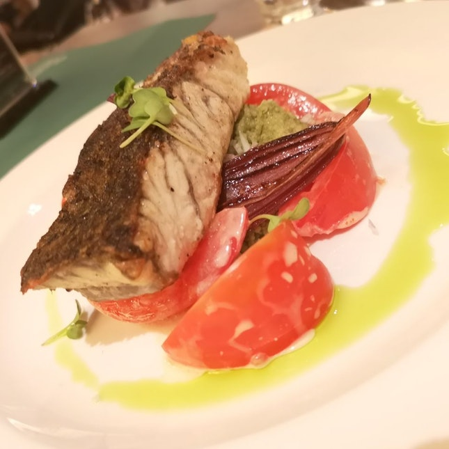 Barramundi, tomatoes, cous cous