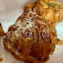 Ham & Cheddar Croissant | $5