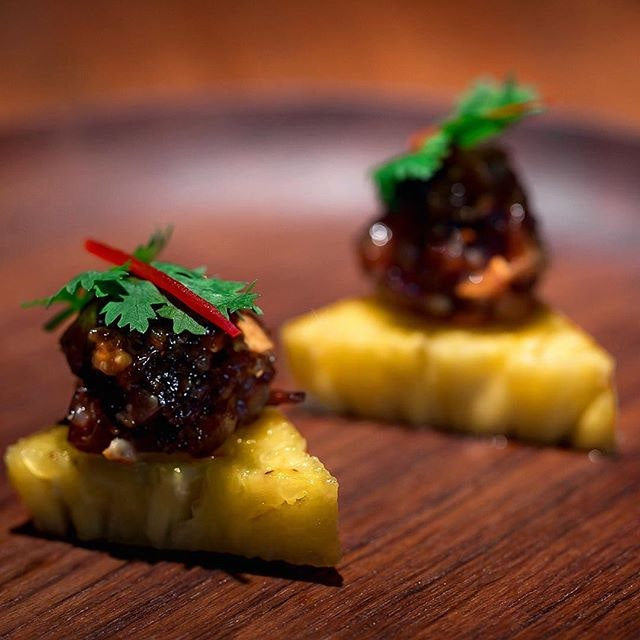 Pineapple triangle, minced chicken, shrimp, nuts and palm sugar.