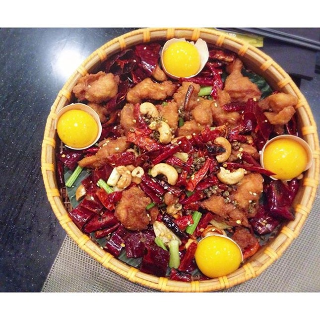 Firecracker Chicken Nest ($24) Fusion of Kung Pao diced chicken deep-fried with substantial portion of dried chillies & cashew nuts.