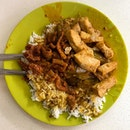 Curry rice with pork chops, eggplant & beancurd.