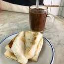 Coffee with buttered kaya toast _ In a Coffeeshop where time stood still.