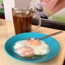 Coffee with soft boiled eggs.