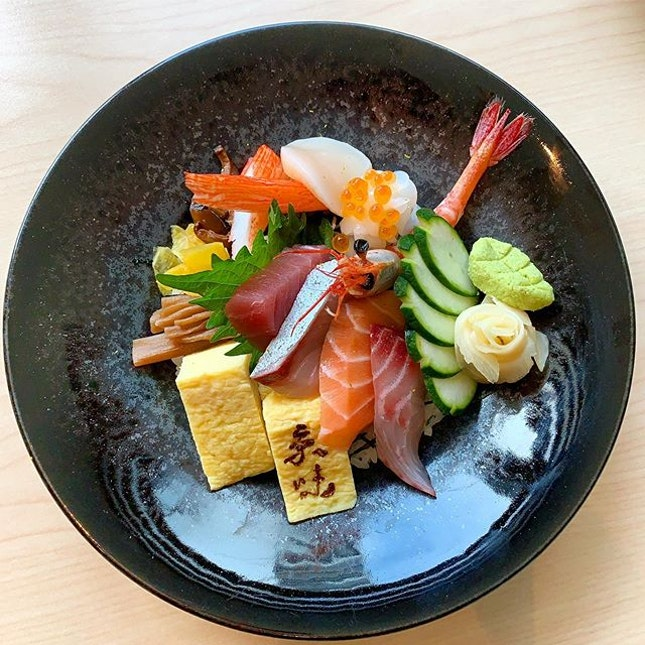 Chirashi Don  _ Thick slices of the freshest fish adorn a bowl of Japanese rice for all sushi lovers.