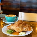 Croissant and Cappuccino  _ French butter, French ingredients used for making the Croissant.