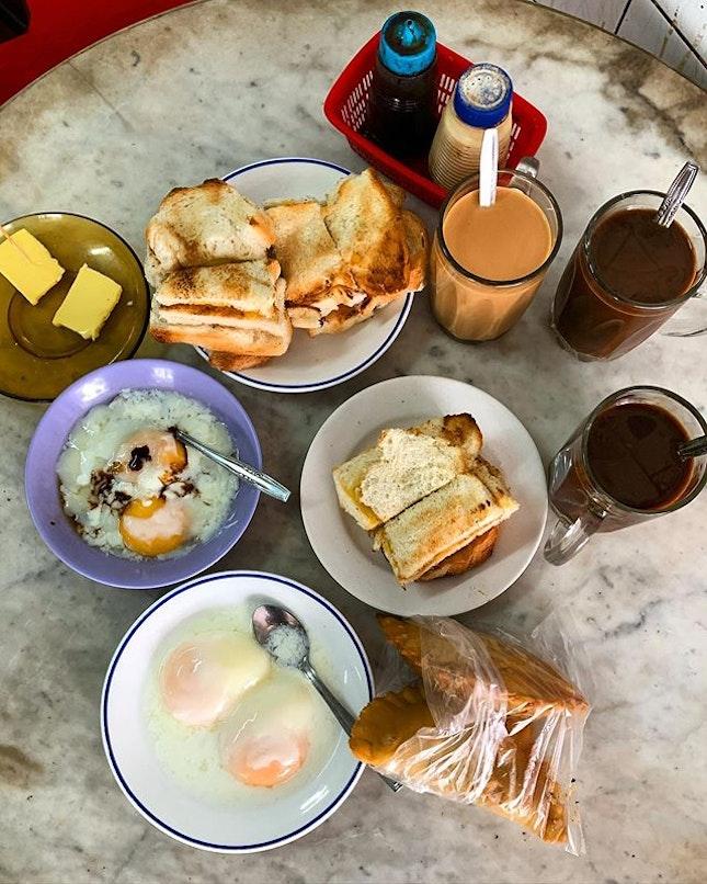 Of buttered toast, soft boiled eggs, potato epok epok, coffee and tea.