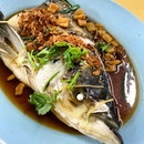 Steamed Song Fish Head HK style _ Fresh water fish steamed with soya, oyster sauce with lardon bits & fried shallots.