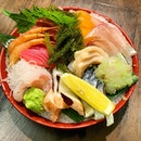 Sashimi 11 kinds _ Shake, Kanpachi, Mekajiki, Australian Silver Perch topped with wasabi Tobikko, Saba, Tako, Tai, Akami, Hamachi, Hotate hidden below the Okinawa Sea Grapes  _ Fishes arrived from Japan & Australia today.