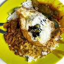 Hainanese Curry Rice _ Pork chops, braised eggplant & running egg  _ Simple, messy, additively shiok  _ #sqtop_hawkerfood #SupportLocalFNB #SaveFnBSG #LoveyourLocalSG #FoodinSingapore  #WhatMakesSG  #OurHawkerCulture  #OurSGHeritage  #uncagestreetfood #jiaklocal #jiaklocalsg  #PassionMadePossible #TasteObessionSingapore #STFoodTrending  #SGCuisine  #wheretoeatsg #eatmoresg  #burpple #burpplesg  #burpplebeyond