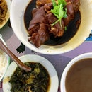 Braised Pork Trotter w side of mustard greens  _ Fork tender meat; succulent, chewy skin.