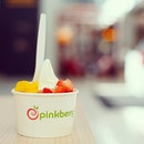 Beat the heat with some frozen yoghurt, with extra toppings of strawberry and mango.