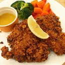 Cereal chicken--cornflakes encrusted chicken batter makes for s damn satisfying crunch.