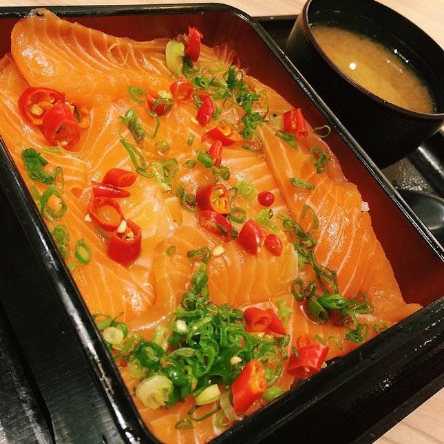 Ichiban Jyu - salmon sashimi, sesame oil and chilli padi on a bed of rice.