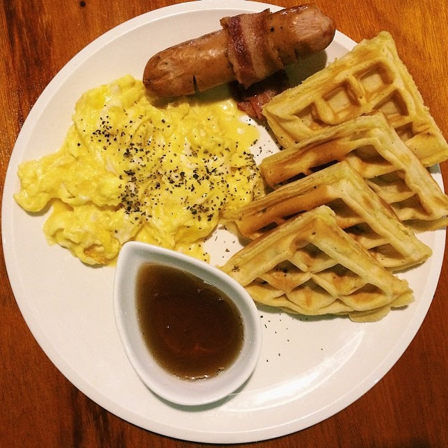 Waffle breakfast – waffle with pork sausage, bacon, scrambled eggs & maple syrup.