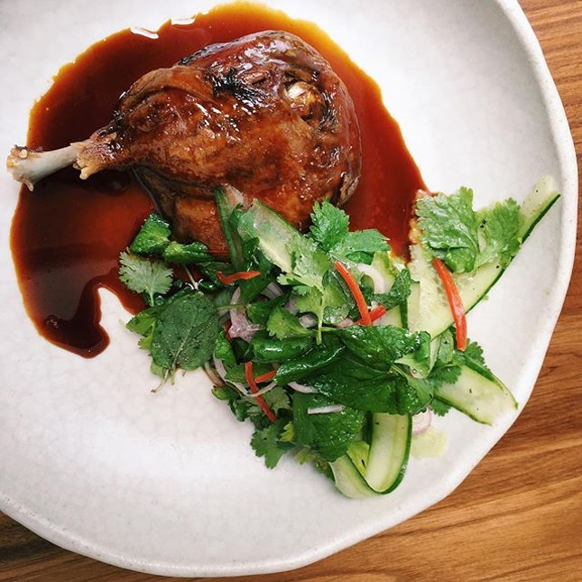 Confit duck leg with five spice caramel, cucumber, and waffles from Cheek by Jowl.