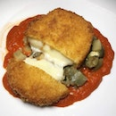 "The Early Fatback: Melanzana, Provola e Pomodoro (Stew of Eggplant, Breadcrumb-crusted Mozzarella, Roma Tomato Coulis), one of the mains from the ""Domenica Italiana"" weekend brunch menu at LaBrezza, St."