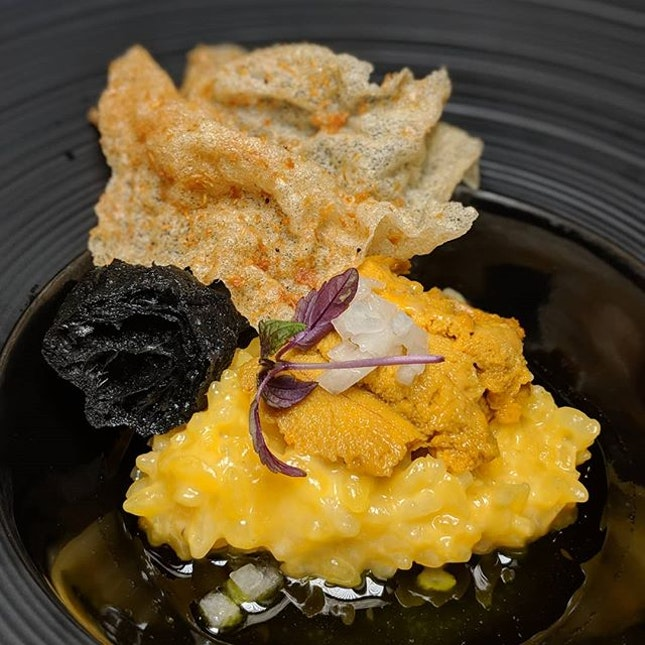 Congee (akitakomachi rice, Japanese dried scallops and dried anchovy broth, uni, charcoal youtiao, nashi pear and sakura ebi) from Le Binchotan (@lebinchotan).