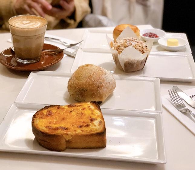 Tuna Croque Monsiuer ($4.80+), Olive Bread ($3.20+), Chocolate Almond Muffin ($3.50+), Scone ($3.20+)