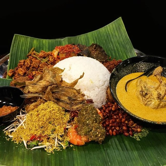 Nasi Ambeng (S$50.80) consists of rice, chicken, beef, tofu, tempeh, eggplant, lungs, sambal, serunding, prawns, urap (veggie with coconut) and fried salted fish .