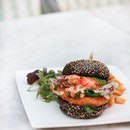 Favorite new menu from @dtccsg: Seafood Fiesta Charcoal Burger (S$25++).