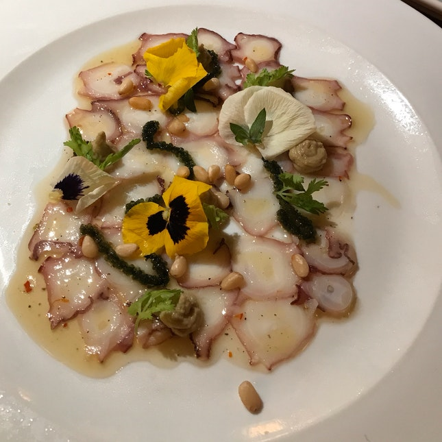Octopus carpaccio | calamansi dressing,  avocado purée, sea grapes & roasted pine nuts [$25]