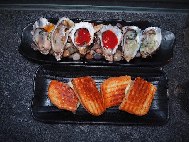 Signature Oysters + Grilled Bikini
