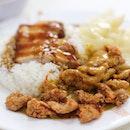 Hainanese curry rice pork chop set with braised pork.