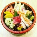 Chirashi Don  An assortment of white tuna, red tuna , salmon, prawns, cuttlefish and jellyfish etc.