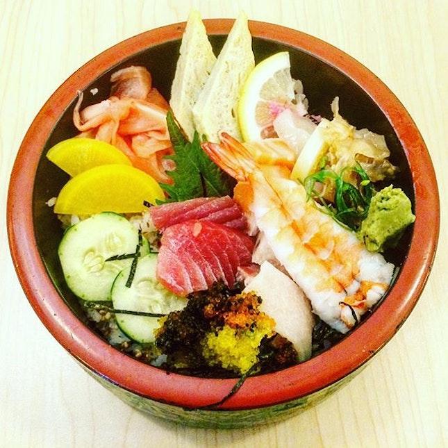 Chirashi Don  An assortment of white tuna, red tuna , salmon, prawns, cuttlefish and jellyfish etc.