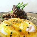 Beef Cheek Polenta Benedict  Slow braised beef cheek on homemade polenta cake, poached local farm eggs with hollandaise sauce, pencil asparagus  Polenta cake consists of mainly maize flour that is soft and brittle.