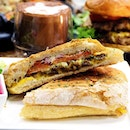 Walking on Sunshine cafe Beef Bulgogi Panini The grilled sandwich is cut horizontally traditionally and filled with deli ingredients such as beef bulgogi, cheese and tomatoes.