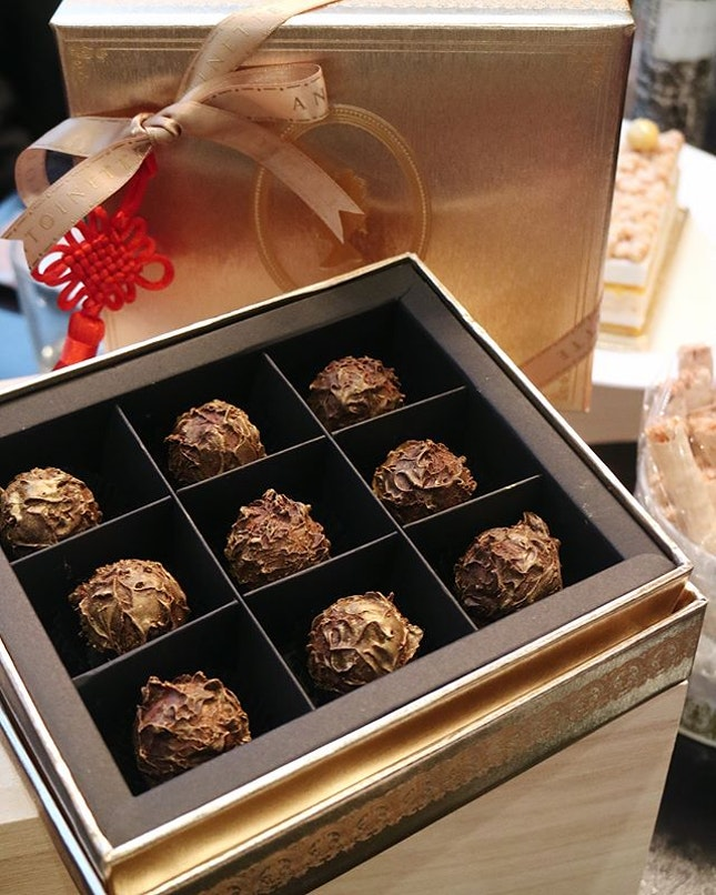 Indulge in these exquisite handcrafted Salted Egg Yolk Truffles($28 for a box of 9).
