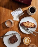 A simple cup of brew accompanied by a croissant or two.