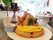 Fried chicken waffle topped with fluffy omelette (RM22) @softlaunchcafe .