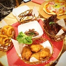 Throwback dinner - our own creations of mix platters, pork ribs, onion rings, medium Welldone rib eye, fried chicken wings, grill squid and bacon pizza.
