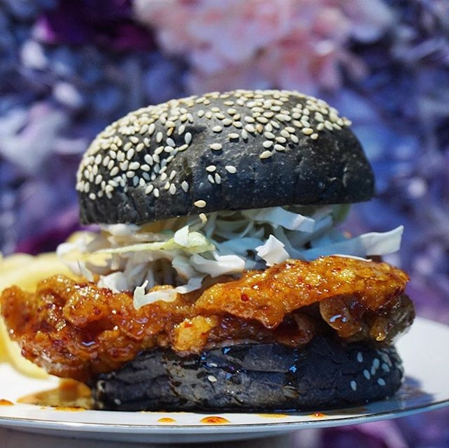 Korean Spicy Chicken Charcoal Burger from @wildbloomssg 🤤