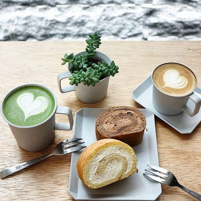 Having coffee and matcha latte paired with swiss rolls.