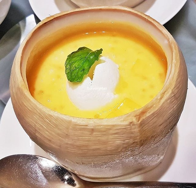 Chilled Mango Cream With Pomelo, Sago, And Ice Cream In Young Coconut (SGD $8.80 per portion) @ TungLok XiHe Peking Duck.