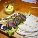 Tequila Marinated Angus Beef Served with Tortilla Wrap, Sour Cream, Pico de gallo and handmade mash potatoes.