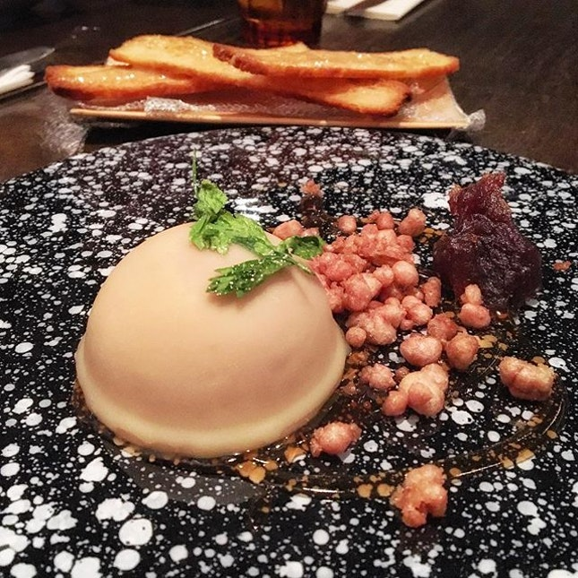 ; The Tribbiani  Rich Duck Liver Mousse encased in fragrant clarified brown butter, grains of puffed Duck Hearts complimented with Date Jam and Pedro Ximenez Glaze.