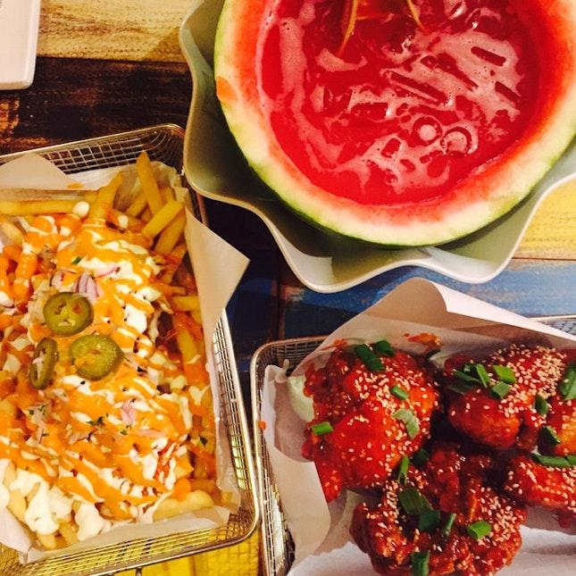 Kimchi fries, spicy chik and watermelon soju