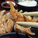Golden brown gyozas with steamed white rice makes the best comfort food ever!